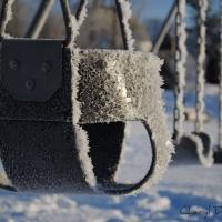 Cheryl Doucet - hoar frost on swings